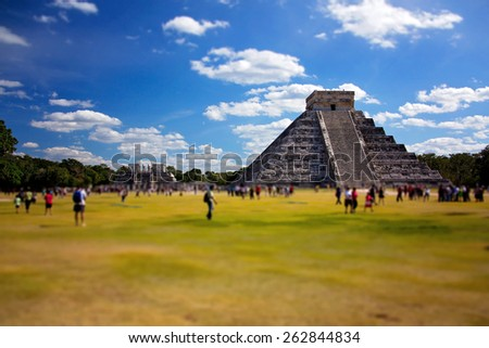 Mayan Ruin, the Pyramid - Chichen Itza Mexico, people walking around, blurred filter applied  - stock photo