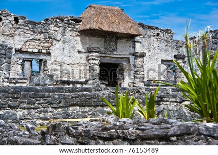 mayan ruins in tulum mexico. dramatic clouds paint a scene of an past time. - stock photo
