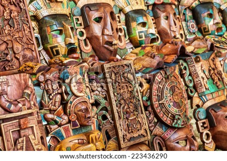 Mayan wooden handcrafted masks in a traditional Mexican market - stock photo