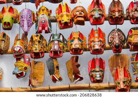 Mayan Wooden Masks for sale, Chichicastenango, Guatemala, Central America - stock photo