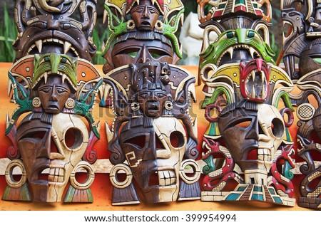 Mayan wooden masks on the street market - stock photo