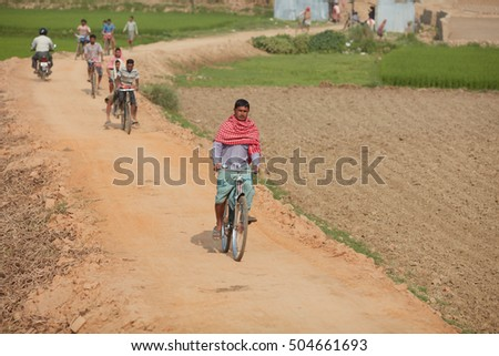 Mayapur - March 16, 2016: Villagers on bicycles are rushing for thel Gaura Purnima festival in Mayapur