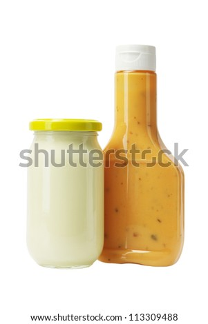 Mayonnaise and Thousand Island Dressing in Glass Bottles on White Background - stock photo