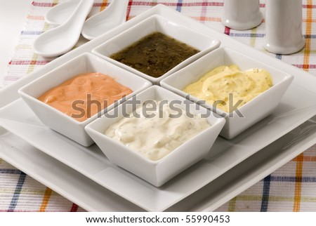 Mayonnaise cheese vinaigrette and cocktail sauces in sauce-boats. Salad dressing. - stock photo