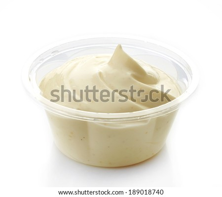 Mayonnaise in a plastic take away container - stock photo