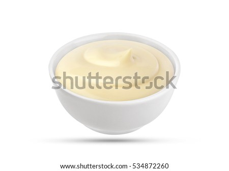 Mayonnaise sauce in bowl isolated on white background with clipping path