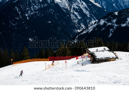 MAYRHOFEN, AUSTRIA :  MARCH 22, 2016:View of  Mayrhofen Ski resort area with ski lifts, pistes and skiers. Zillertal Alps, Tirol.