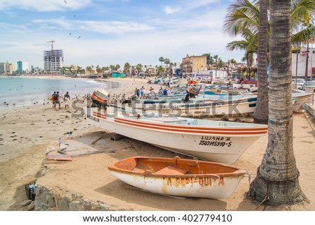 MAZATLAN MEXICO-APRIL 6, 2016: Beaches in Mazatlan return to normal after surging with tourism during Holy Week. - stock photo