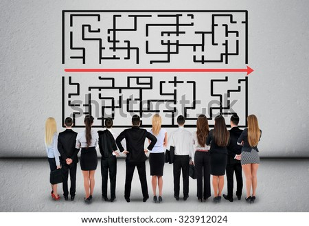 Maze and business team thinking solution - stock photo