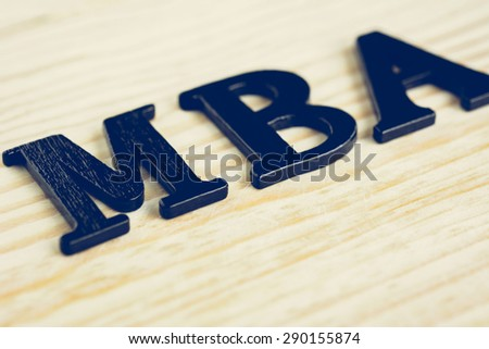 MBA (or Master of Business Administration) sign on wood background - stock photo