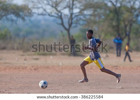 MBABANE, SWAZILAND - AUGUST 6: Orphan Swazi schoolboys playing soccer in a local school on August 6, 2008 in Mbabane, Swaziland. 10 percent of Swaziland's total population are orphans, due to HIV/AIDS - stock photo