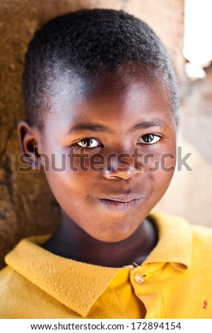 MBABANE, SWAZILAND - AUGUST 5: Portrait of unidentified orphan Swazi boy on August 5, 2008 in Mbabane, Swaziland. Close to 10 percent of Swaziland's total population are orphans, due to HIV/AIDS. - stock photo