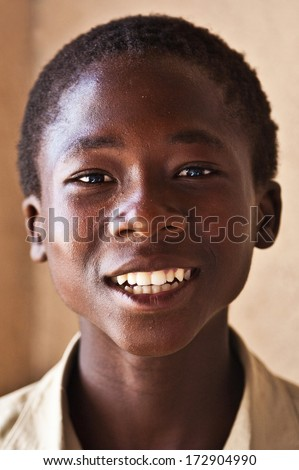 MBABANE, SWAZILAND - AUGUST 5: Portrait of unidentified orphan Swazi boy on August 5, 2008 in Mbabane, Swaziland. Close to 10 percent of Swaziland's total population are orphans, due to HIV/AIDS.