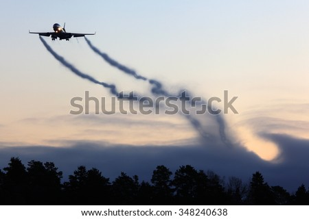 Mcdonnell Douglas MD-11F civil cargo airplane landing with vortexes coming from wingtips. - stock photo