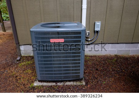 MCKENZIE BRIDGE, OR - MARCH 4, 2016: Goodman HVAC unit on the outside of a vacation house. - stock photo