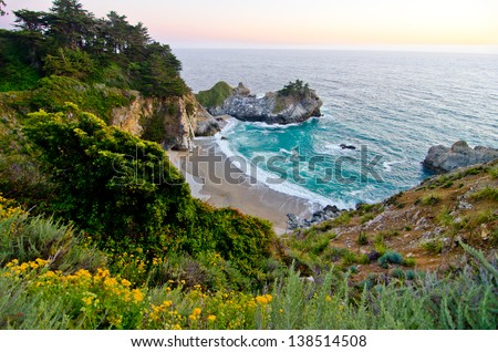 McWay Falls at Julia Pfeiffer Burns State Park in California is one of the few waterfalls in the world that falls directly into the ocean. - stock photo