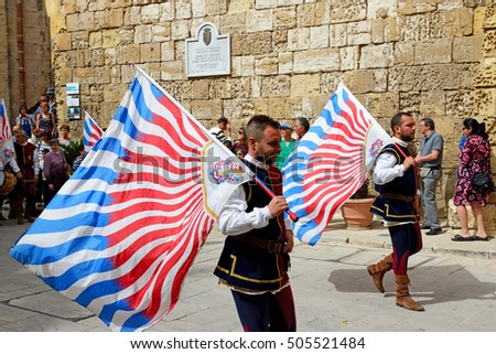 MDINA, MALTA - APRIL 19: The Mdina medieval festival and tourists on April 19, 2015 in Mdina, Malta. More then 1,6 mln tourists is expected to visit Malta in year 2015.