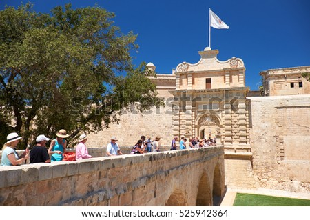 MDINA, MALTA - JULY 29, 2015: The view of the main entrance to Mdina with the Main Gate and the Mdina Gate Bridge over Lorenzo Calleja ditch. Malta