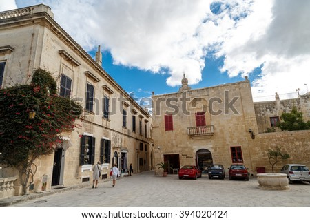 MDINA, MALTA - NOVEMBER 1, 2015 : View of Mdina streets with limestone historical buildings around, on cloudy sky background.