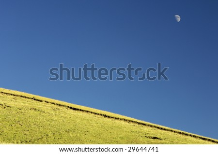 Meadow and moon in Pyrenees