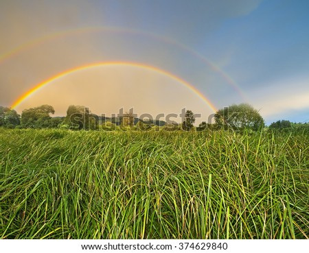 meadow and rainbow - stock photo