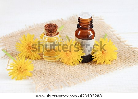 Meadow flower dandelion cosmetic products. Skincare benefits.  - stock photo
