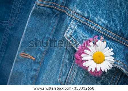 Meadow flowers in buttonhole of denim jacket; Casual look; Expression of zest for life - stock photo