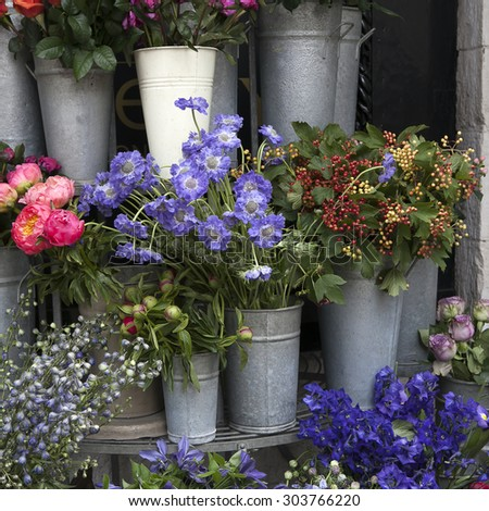 Meadow flowers lupines, buttercups, bluebells, and Aquilegia in a bouquet hawthorn. - stock photo