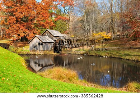 MEADOWS OF DAN, VIRGINIA, USA - OCTOBER 2012: Mabry Mill with pond, one of the attractions on Blue Ridge Parkway, Virginia USA in Autumn.