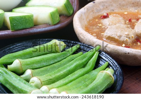 Meal for vegetarian with menu: bottle gourd, okra, egg, cooked rice, soya cheese. This Vietnamese food very delicious, nutrition, cholestorol free with organic, cheap ingredient and  for diet people - stock photo