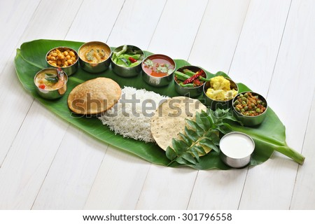 meals served on banana leaf, traditional south indian cuisine - stock photo
