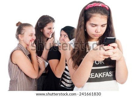 Mean and bullying teen girls on white background - stock photo