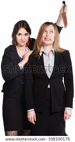 Mean female co-workers with knife behind her head - stock photo