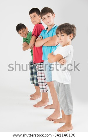 Mean little guys standing and looking ser?ous - stock photo