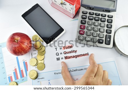 Meaning of TQM with document, money, clock, apple, calculator and magnifier., concept for business - stock photo