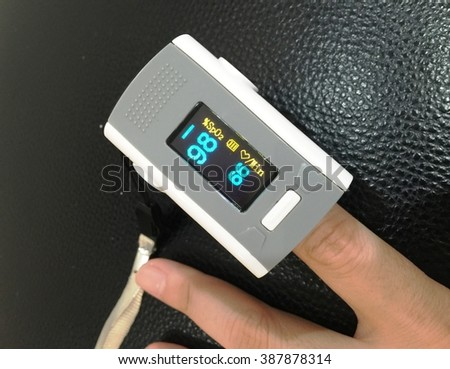 measure pulse rate and oxygen levels  - stock photo