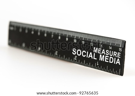 Measure social media on black ruler - stock photo