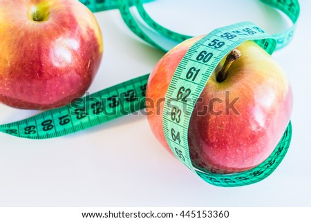 Measure tape and apples dieting concept