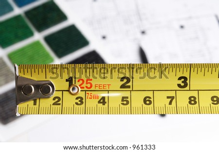 measure tape and architectural plans and materials