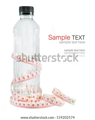 Measure tape wrapped around a bottle of water isolated on white  - stock photo