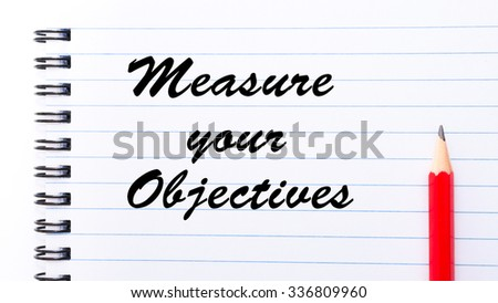 Measure Your Objectives written on notebook page, red pencil on the right. Motivational Concept image