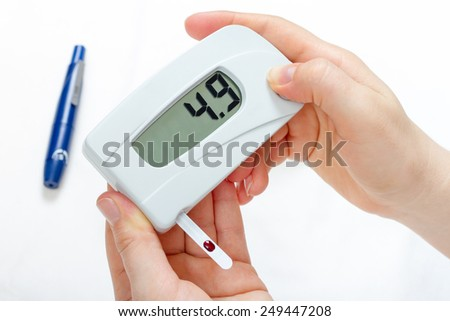 Measurement of blood glucose level digital device in diabetes - stock photo