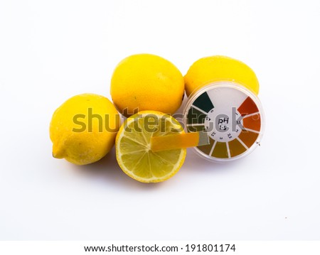 Measurement of lemon pH with pH paper. - stock photo