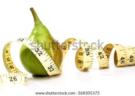 Measurement tape and pears on white background