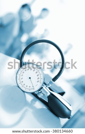 Measuring blood pressure in the staff room at the hospital. - stock photo
