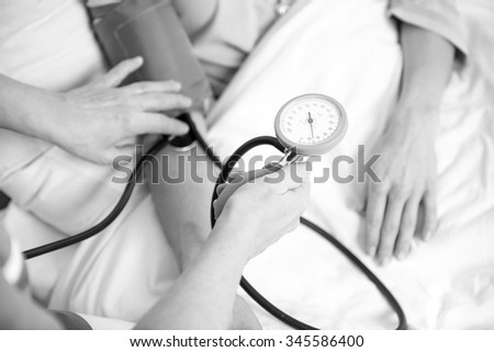 measuring blood pressure of patient in a hospital