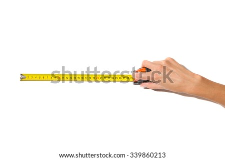 Measuring. Close up of woman's hand holding yellow roll measuring tape. Studio shot on white background.