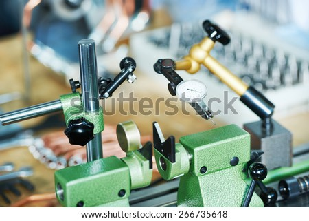 Measuring equipment micrometer at manufacturing industry factory - stock photo