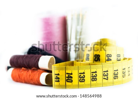 Measuring tape and spools of a tailor - stock photo