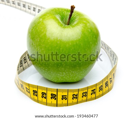 Measuring tape around a green apple, isolated on white